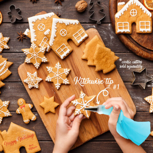 Icing process of Christmas bakery. Unrecognizable woman decorating homemade cookies
