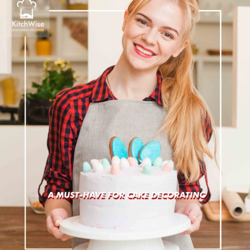 Girl with white cake in kitchen. Cookery desserts.